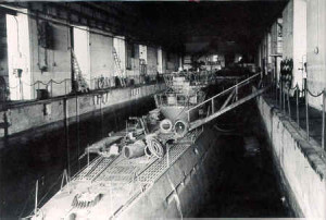 Interior of a pen at St. Nazaire in May 1945. One of the last from a fleet of 1,100 U-boats.